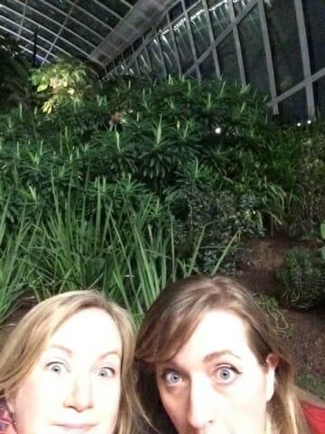 selfie with greenery behind