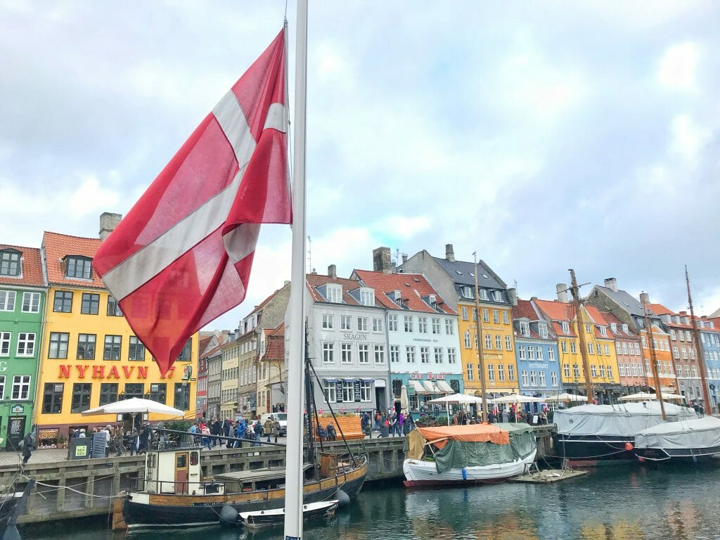 Copenhagen gin guide - Danish flag at Nyhavn port