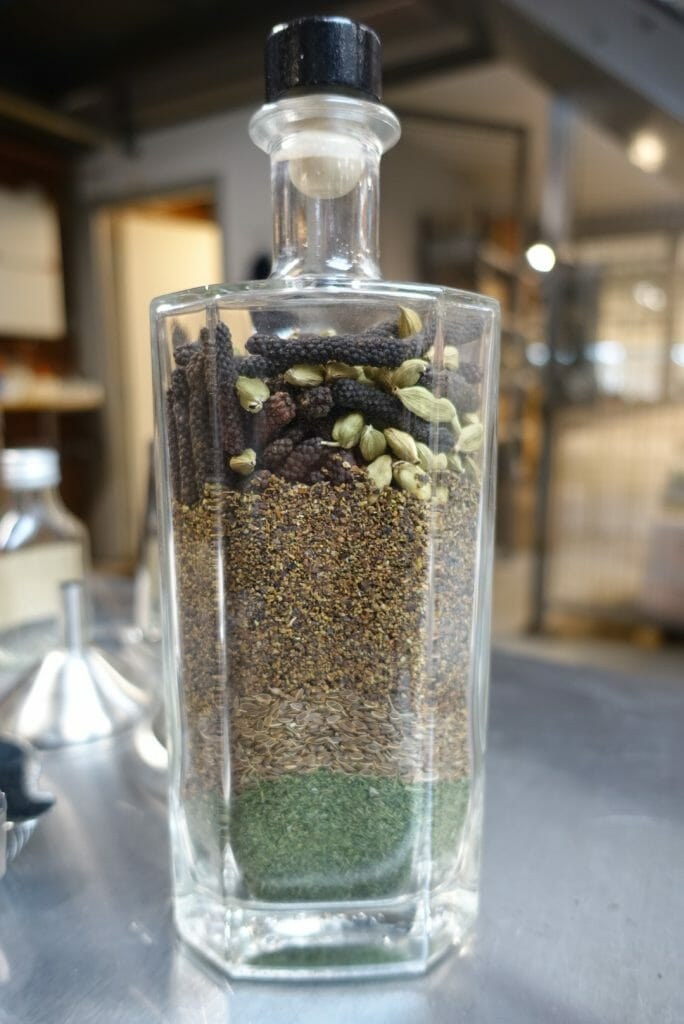 Glass bottle full of the botanicals they use