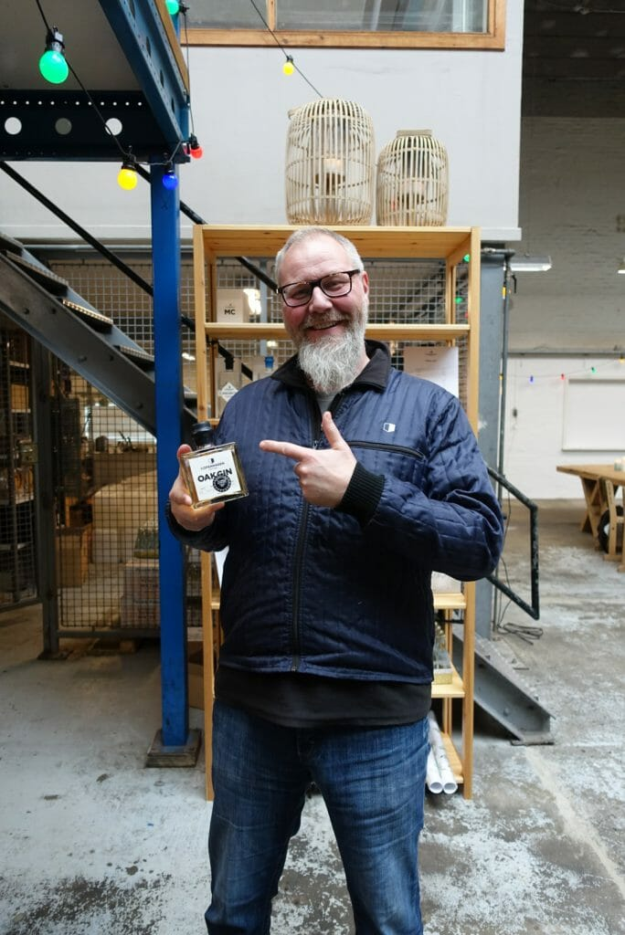 Master distiller Henrik Brinks holding the Oak gin