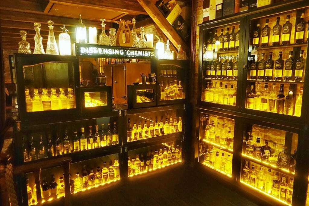 Whiskey room with dispensing chemist decoration