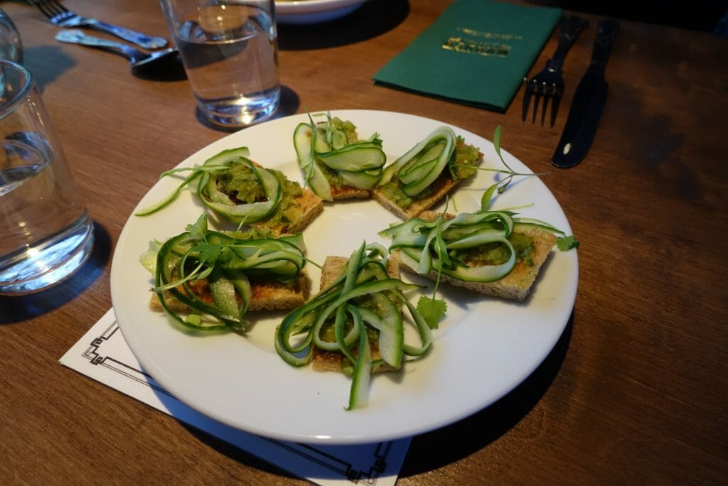 Ribbons of cucumber on toast