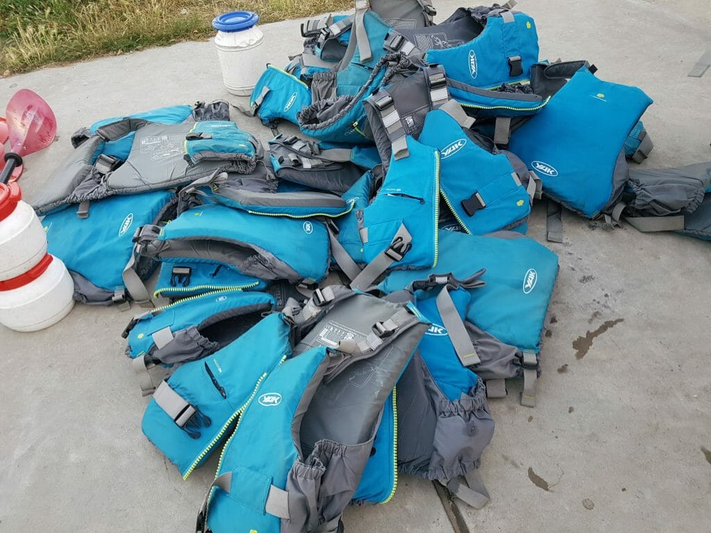 The pile of life jackets at the end of the kayak