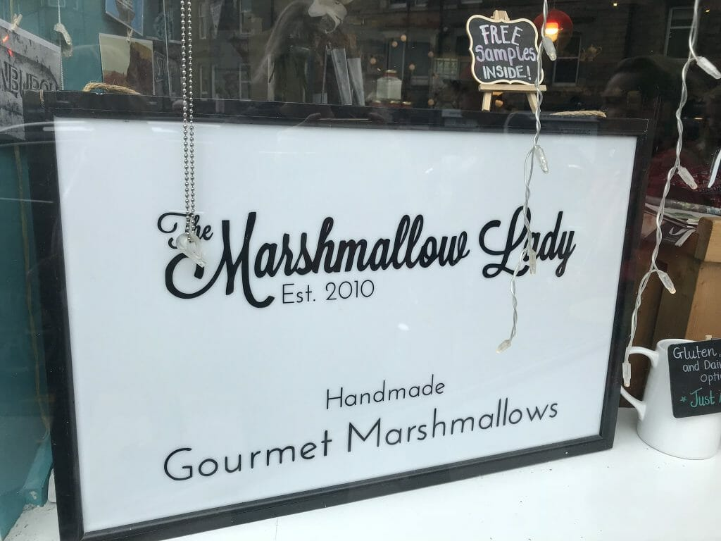 The Marshmallow Lady sign offering free samples!