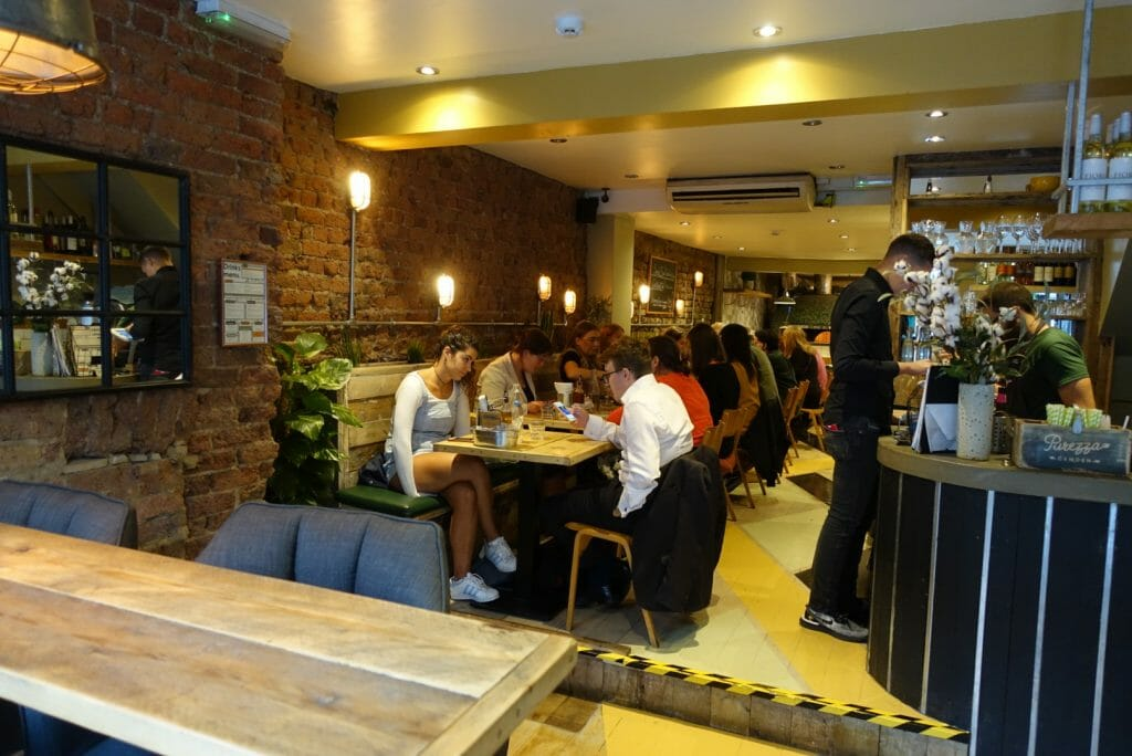 View of the inside of Purezza vegan pizzeria restaurant in Camden
