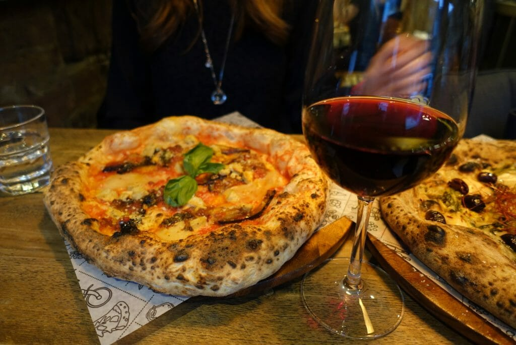 The aubergine pizza and glass of red wine