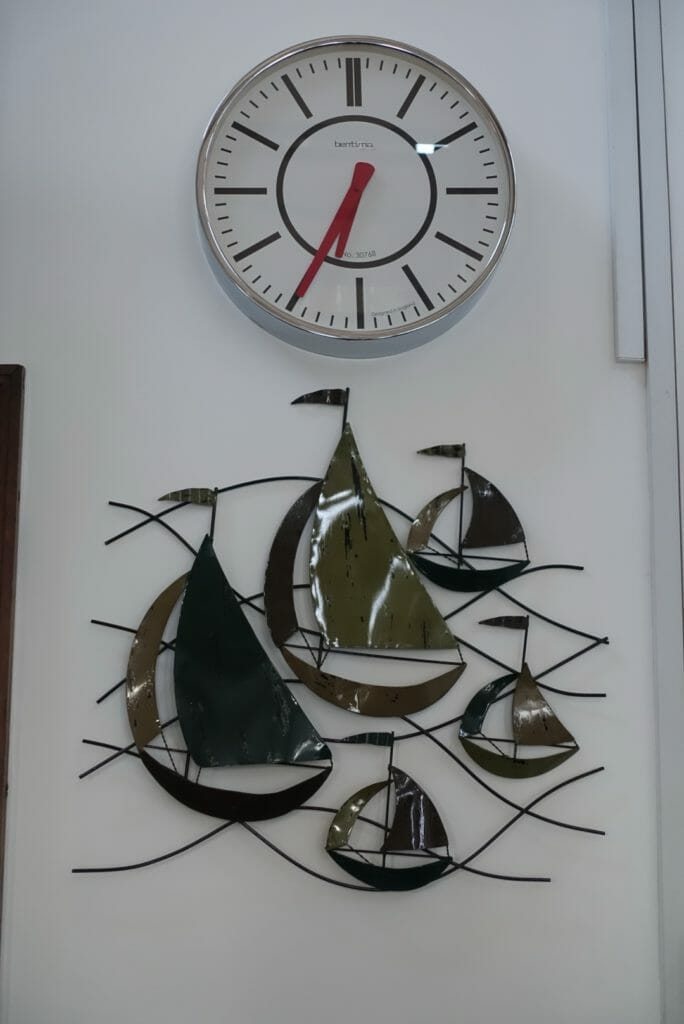 A metal decoration of boats on the wall