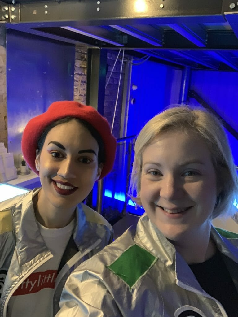 Ana in red beret and silver jacket with Katie