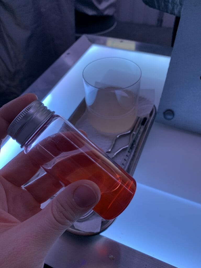 Red liquid in a vial