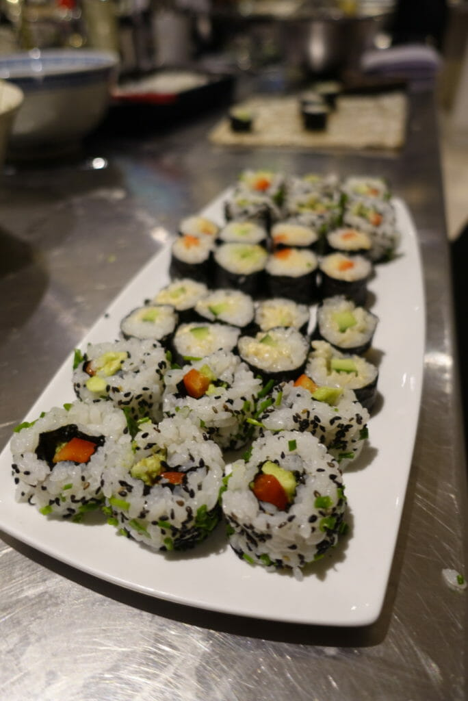 A plate of finished sushi rolls