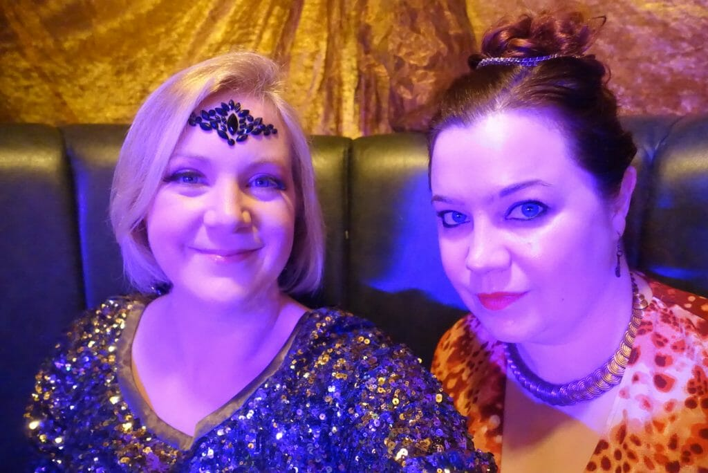 Katie with glitter and sequins and Becky with a classical Goddess look