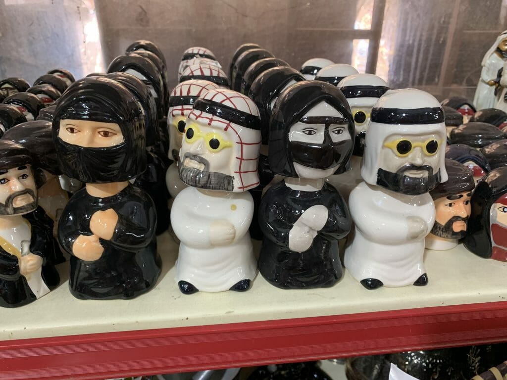 Bobble heads in arabic dress as a bit of fun
