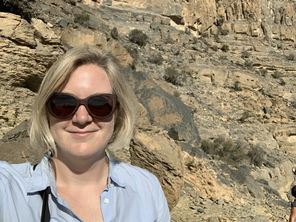 Katie at the Grand Canyon wearing a blue cotton shirt