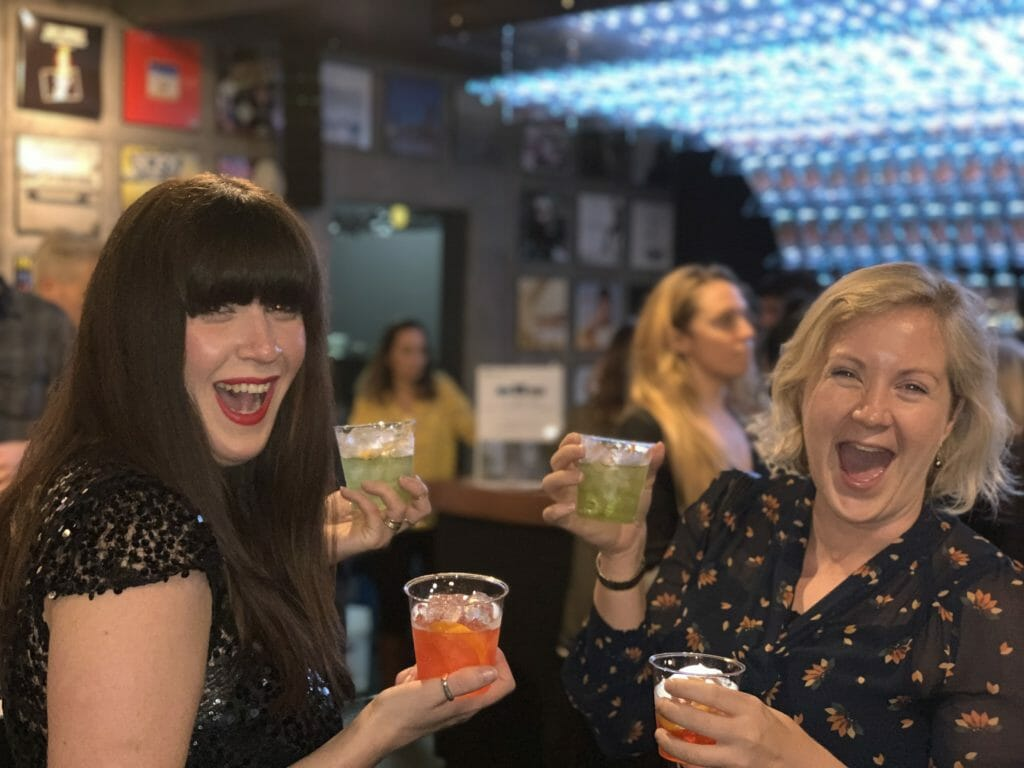 Katie and Nat from Gin Obsessions laughing at the camera