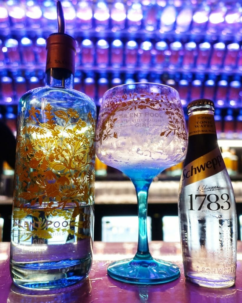 The blue patterned Silent Pool bottle and matching glass with Schweppes tonic