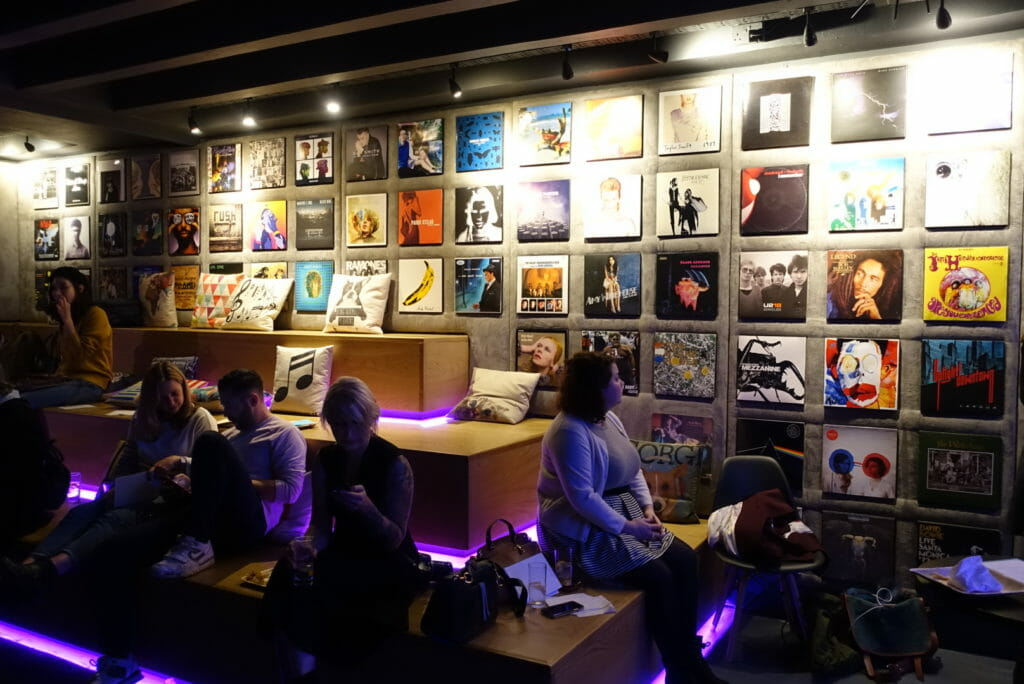 Staged informal seating and album covers as wall decorations