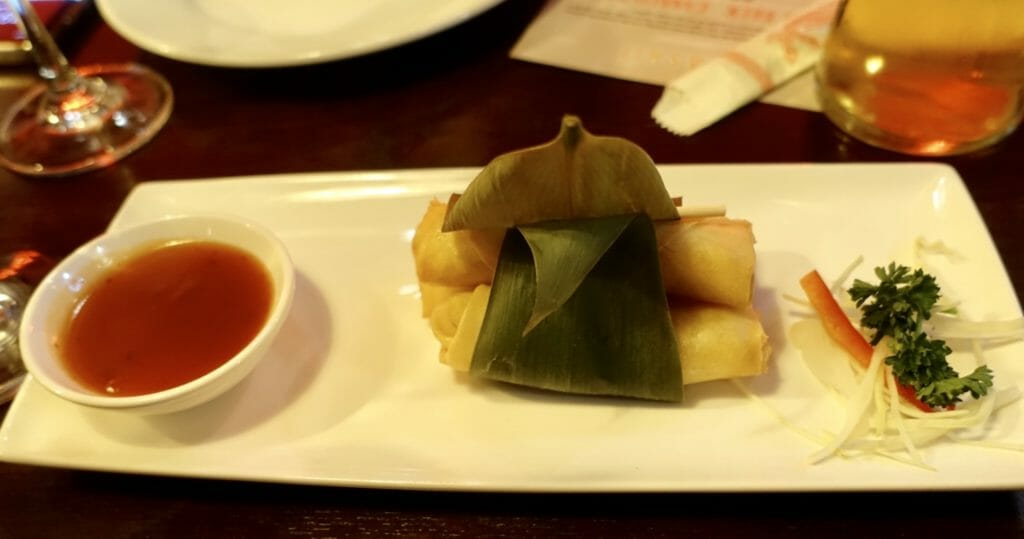 Veggie spring rolls wrapped in a banana leaf