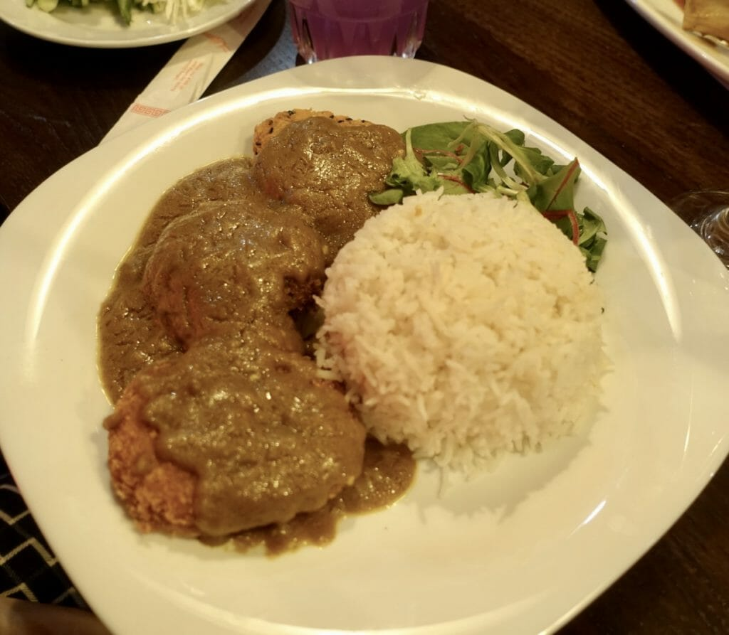 Yasai Katsu Curry - deep fried breaded vegetables with curry sauce, rice and salad garnish