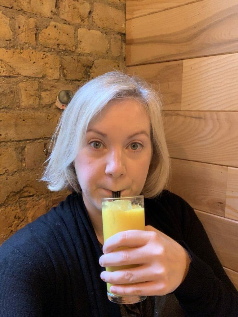 Katie drinking fresh OJ