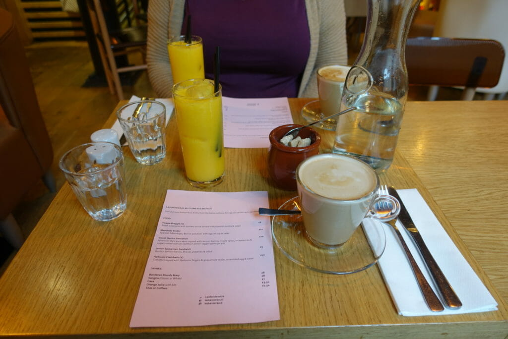 The brunch menu with orange juices and coffees on the table