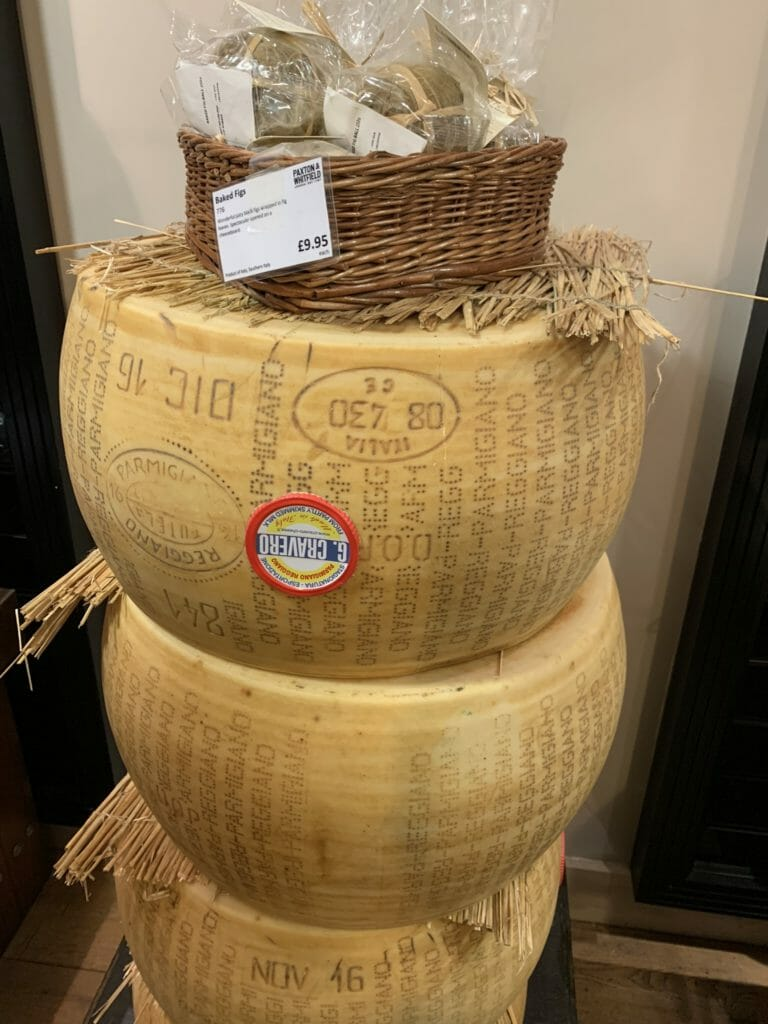 Three massive cheese wheels stacked up