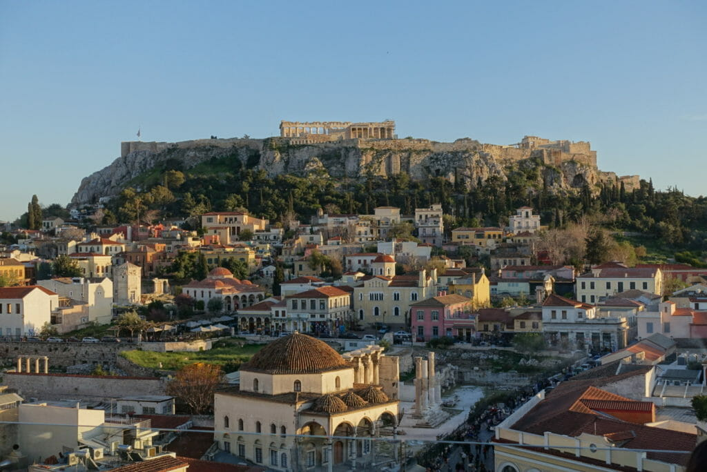 View of the Acropolis from a rooftop bar at sunset