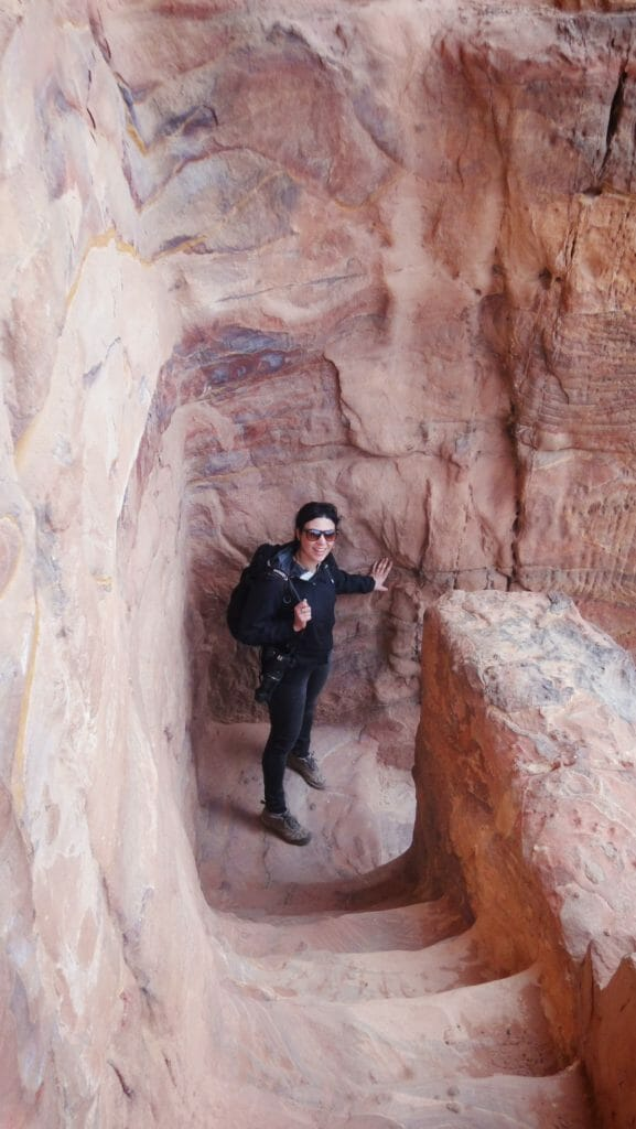 Katies friend on the rock steps in Petra with full hiking gear
