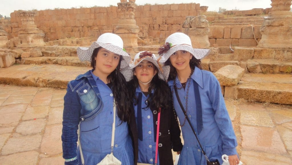 Jordanian girls with cute sun hats at Jerash