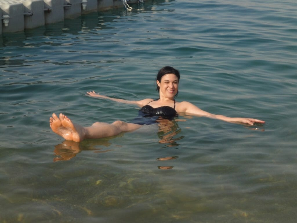 Katies friend floating in the Dead Sea