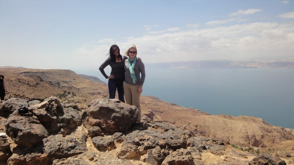 Katie and friend with the Dead Sea in the background