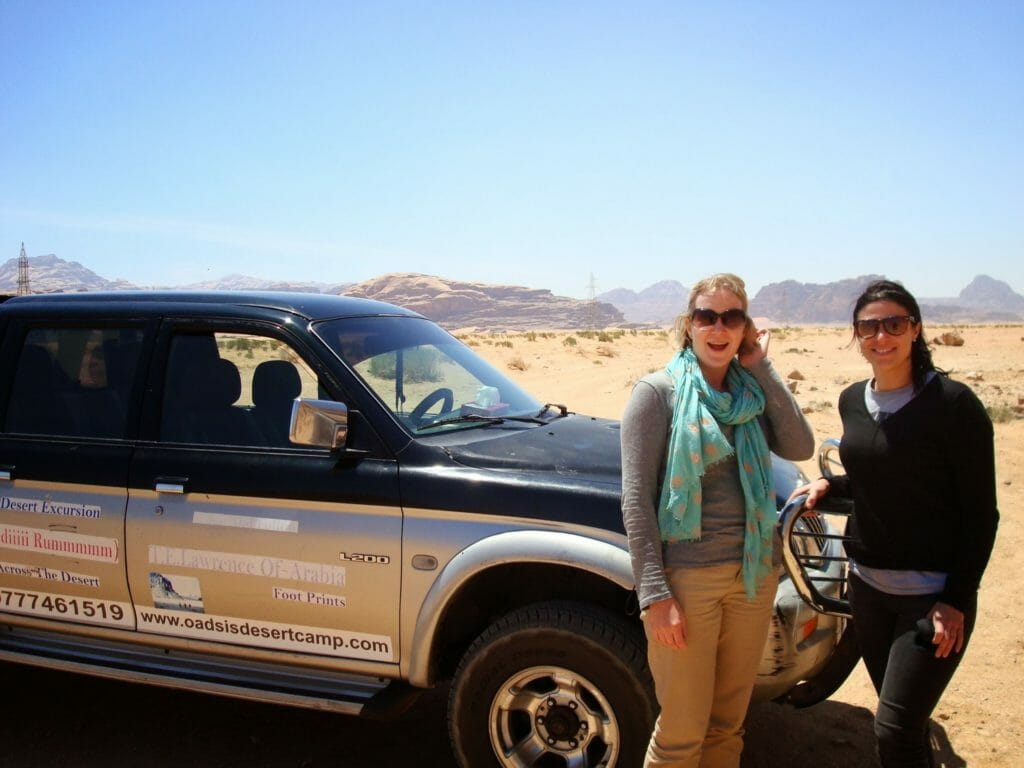 Katie and friend with the truck in Wadi Rum