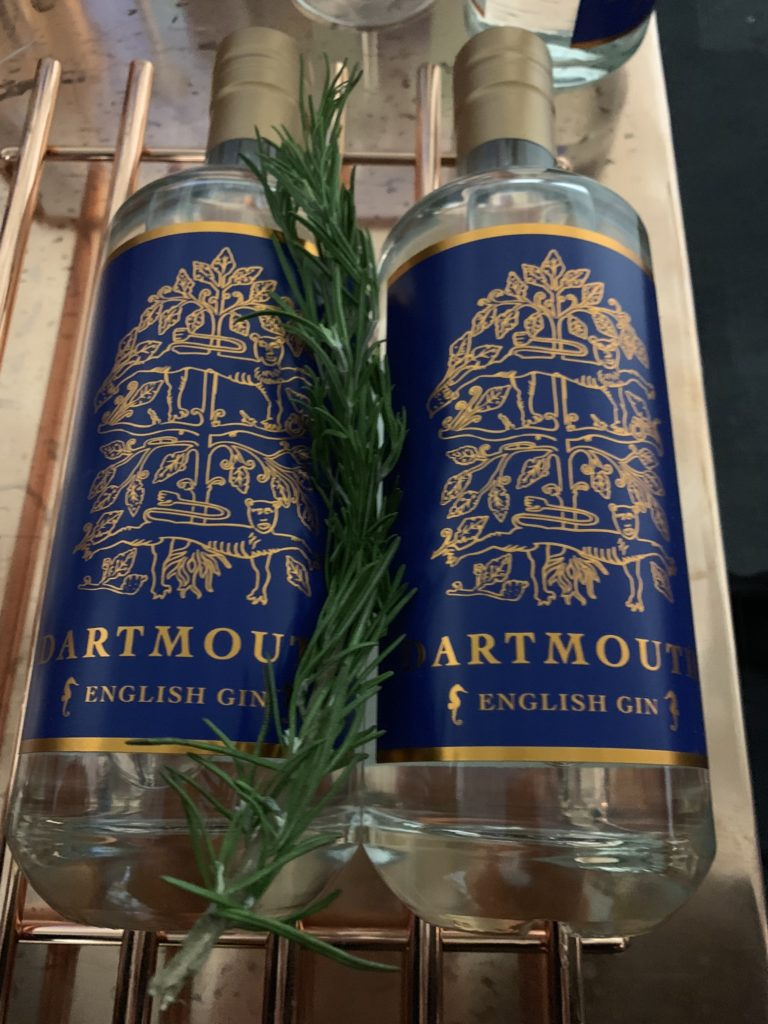 2 bottles of Dartmouth gin with their blue and copper foil labels