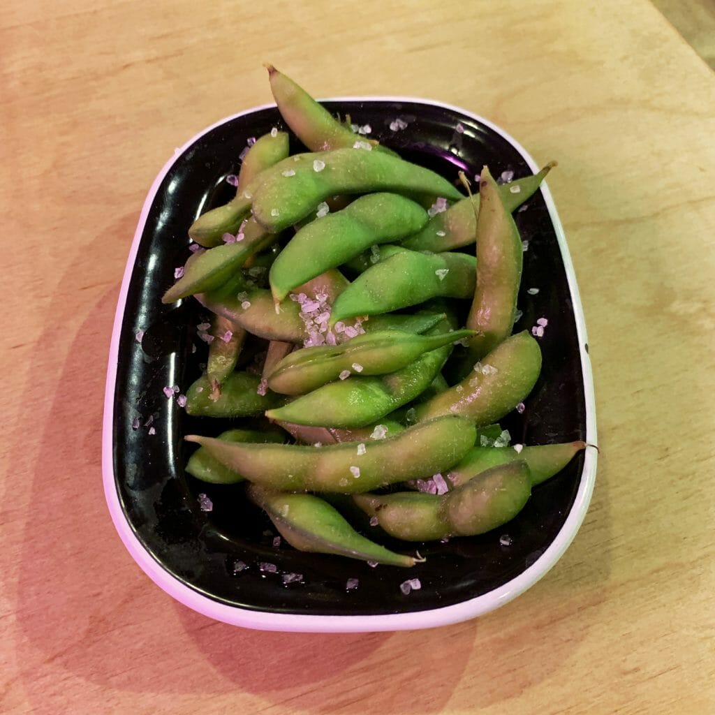 Bowl of salted edamame beans