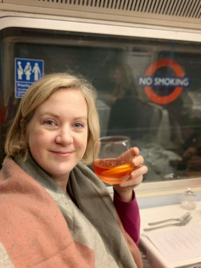 Katie drinking a negroni on the tube!