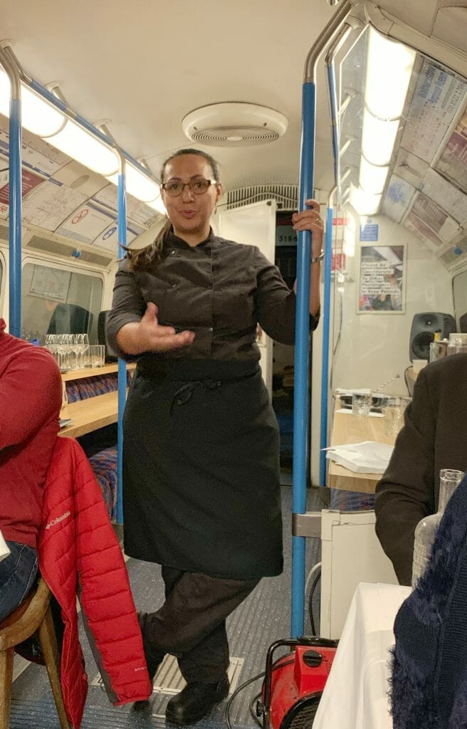 Chef Bea introducing the menu in the tube train