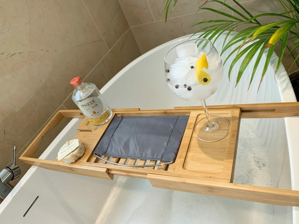 Gin and tonic, Conker Gin bottle and soap on the tray over the bath