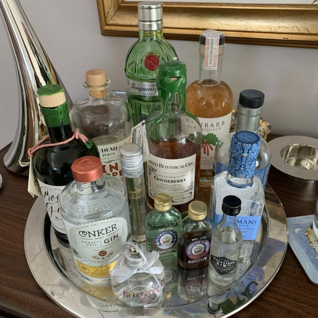 A tray of gin bottles large and small