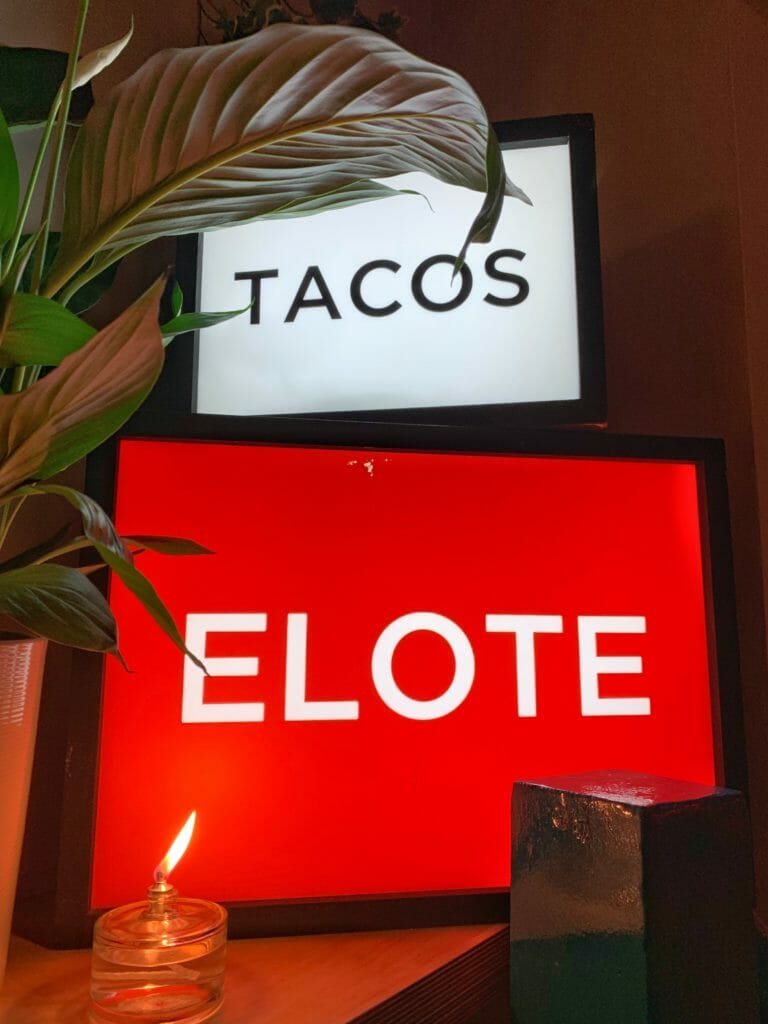 Lightboxes spelling out TACOS and ELOTE
