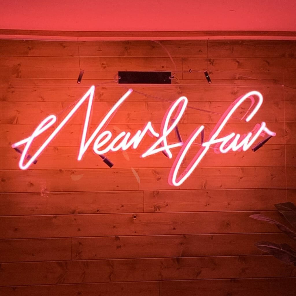 Red neon sign of Near and Far