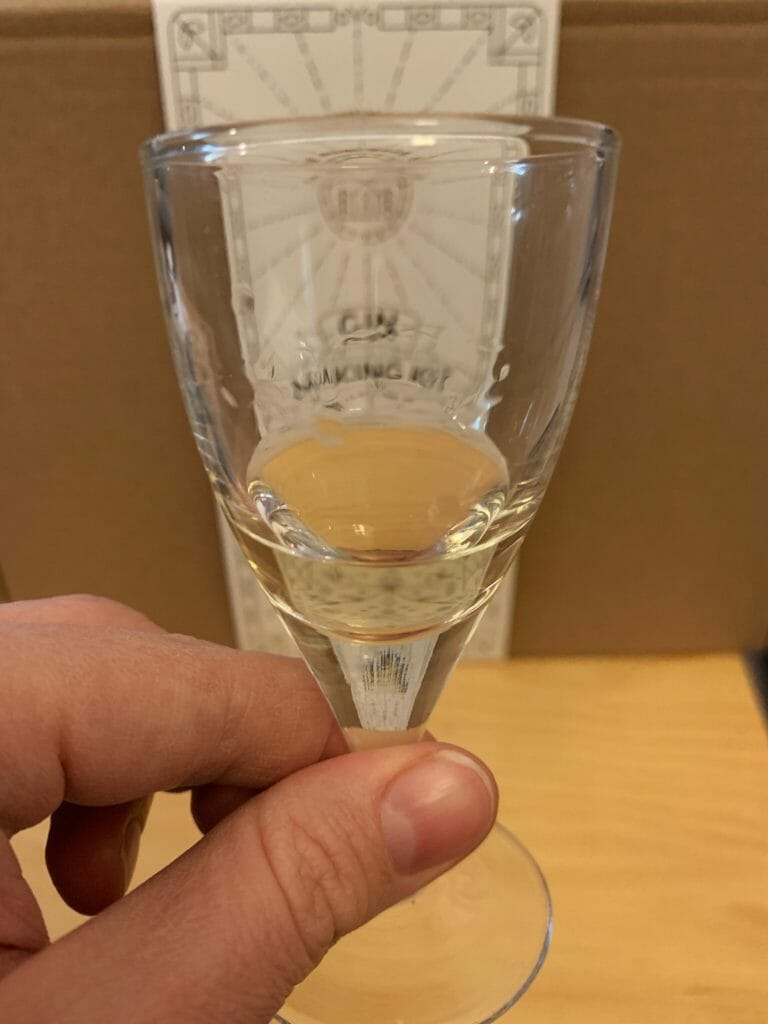 A small sample of the gin in a glass to show the golden colour