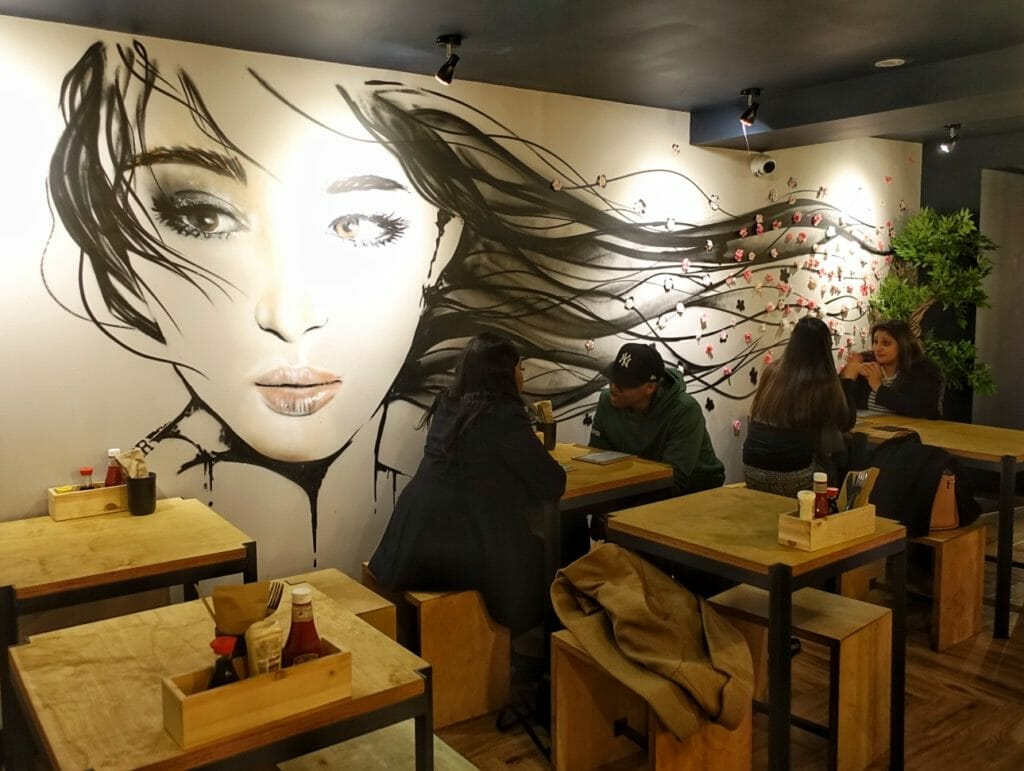 Mural of a girl with long dark hair flowing in the breeze