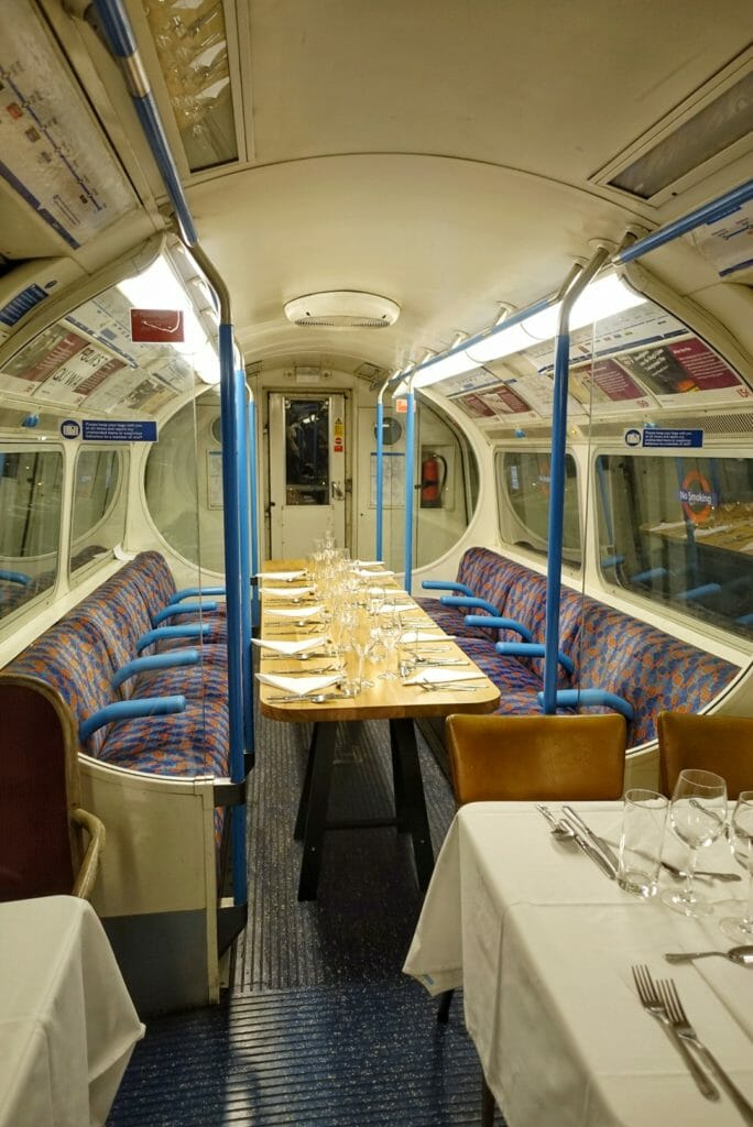 The large table for 12 set up between the tube seats