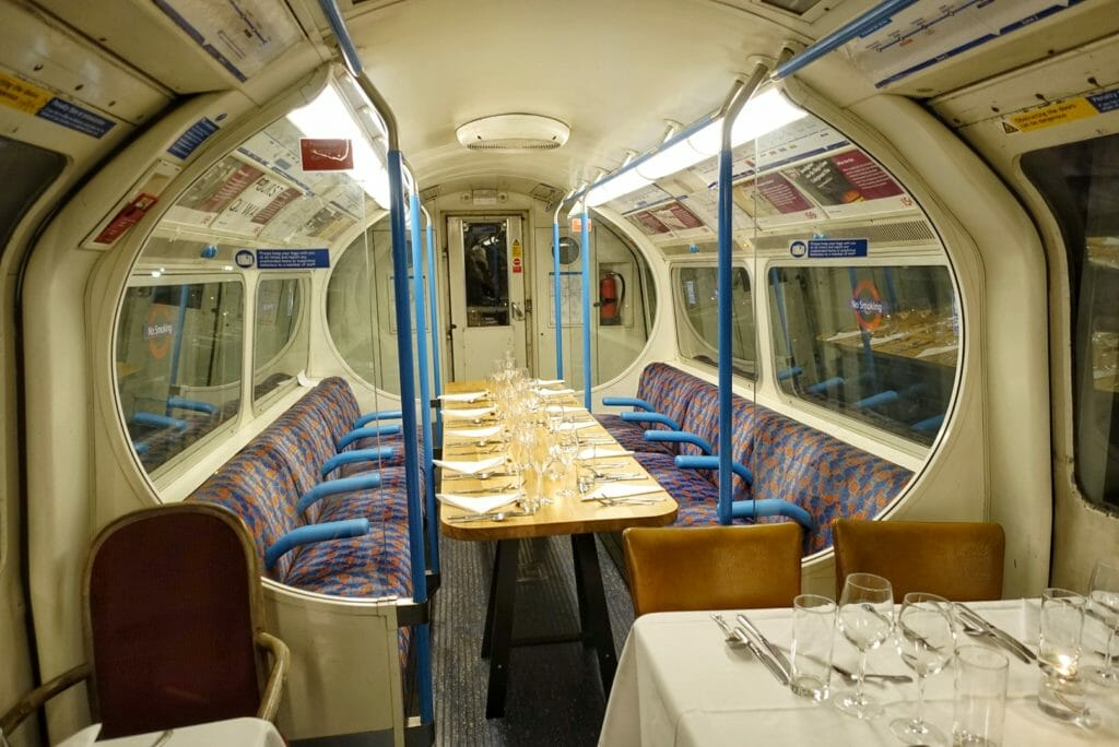 The inside of the Supperclub.tube carriage with tables set for dinner
