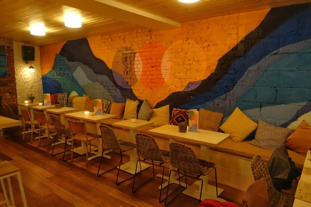 The colourful mural on the other side of the main bar room with low seating