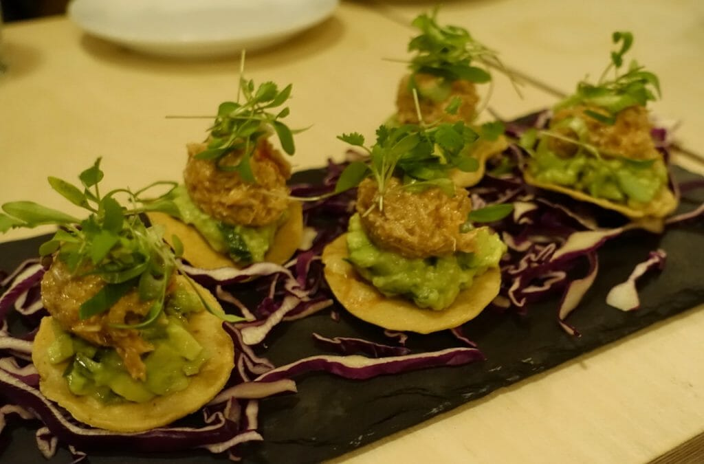 Little toastadas (small round tortillas) loaded with crab and avocado