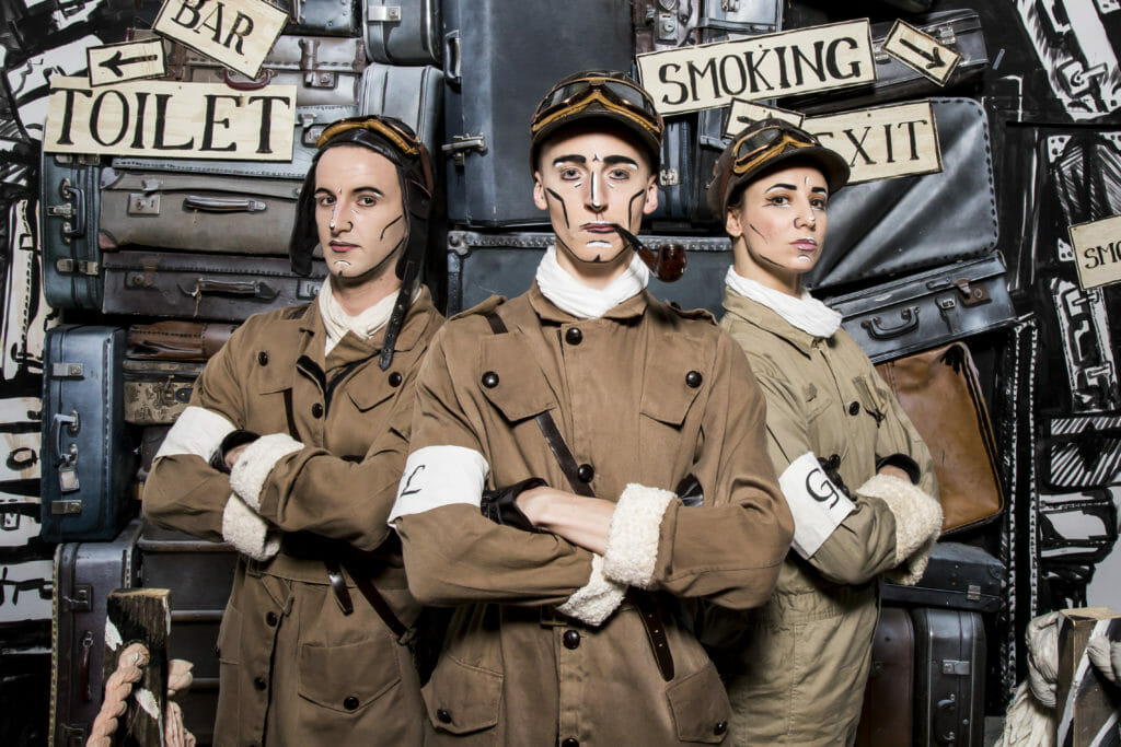 Gingerline cast members in flying uniforms at the Grand Expedition