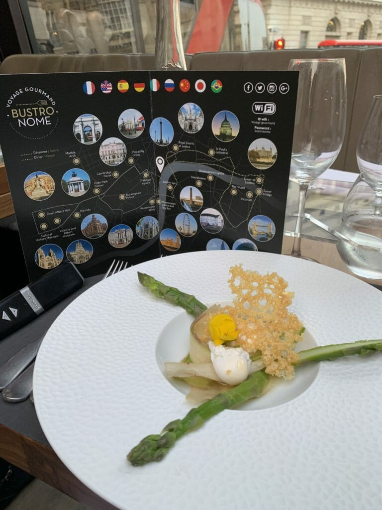 Raw and cooked asparagus with quail's egg and Parmesan crisp