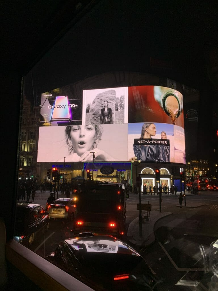 Piccadily Circus lit up at night - another iconic London sight