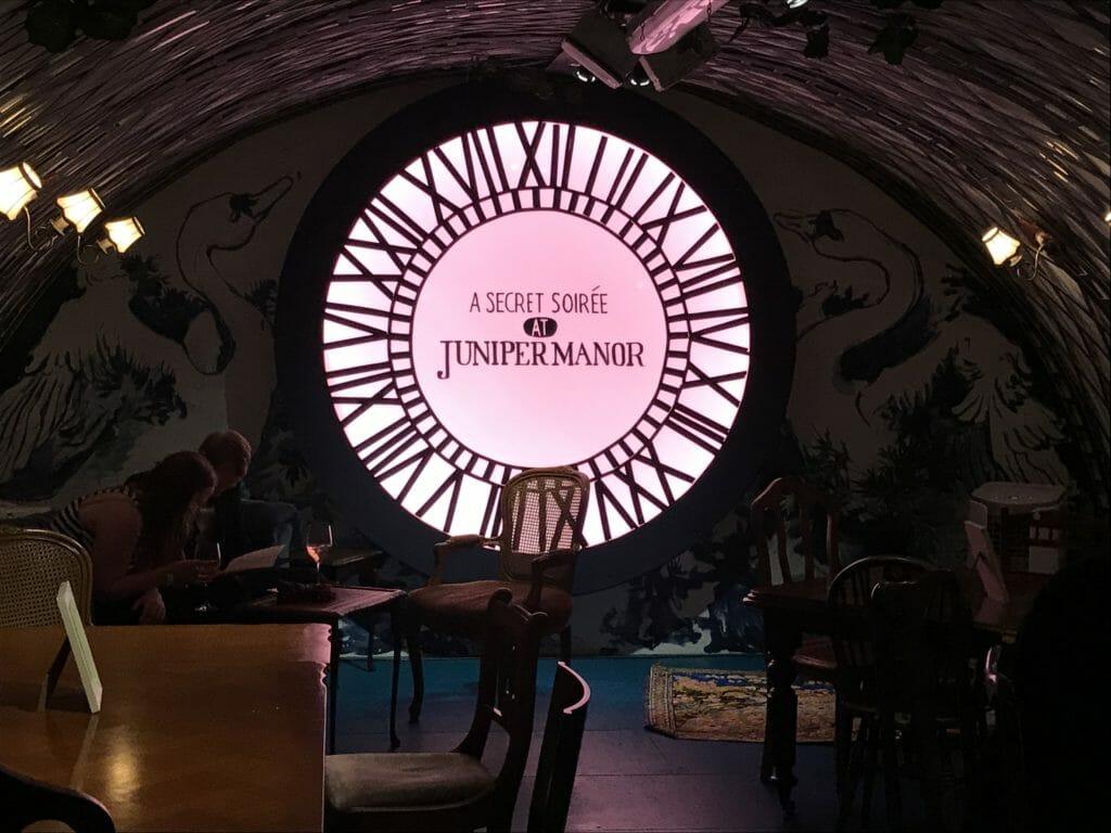 The Juniper Manor bar area with clock shaped light