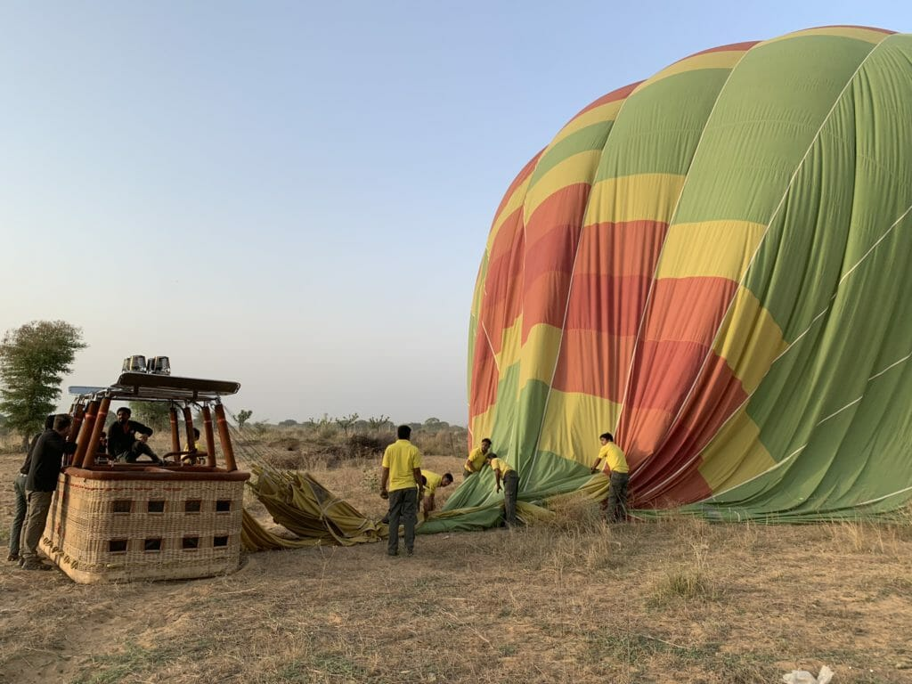 The Sky Waltz crew deflating and packing up the balloon